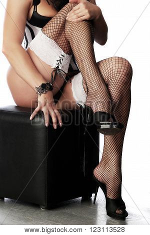 Seductive Lady Sitting On Pouf