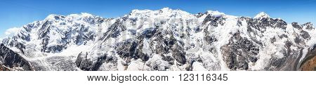 The highest mountain massif of the Caucasus the so-called Bezengi wall. The length is 13 km and has 2 peaks over 5000 m: Shkhara ( 5193m) and Dzhangitau (5085 m)