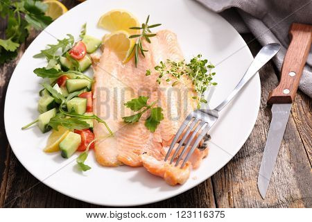 baked fish and salad