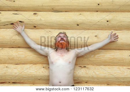 Portrait Of A Man Against The Backdrop Of A Log House