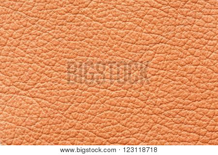 Genuine orange high quality leather texture background
