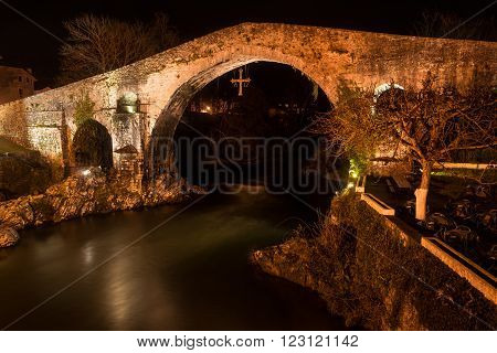 Famous Roman bridge in the city of Cangas de Onis Asturias Spain