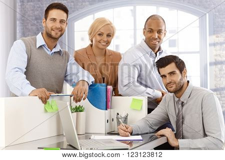 Portrait of confident young businessteam working together.