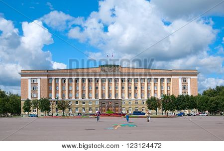 VELIKY NOVGOROD, RUSSIA - JULY 17, 2012: People on The Sophia (Victory) Square. On the background is The Government of Novgorod region