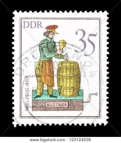 GERMAN DEMOCRATIC REPUBLIC - CIRCA 1983 : Cancelled postage stamp printed by German Democratic Republic, that shows cooper.