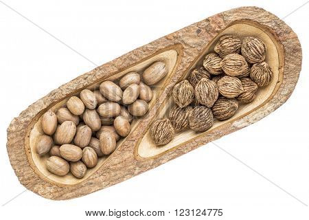 black walnuts and pecans in a mango wood split tray with bark edges, isolated on white, top view