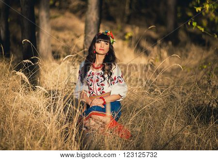 Young brunette woman in national ukrainian clothes