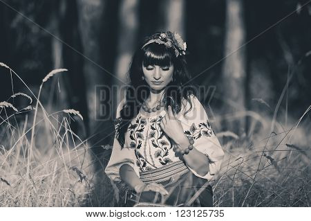 Beautiful brunette woman wearing national ukrainian clothes