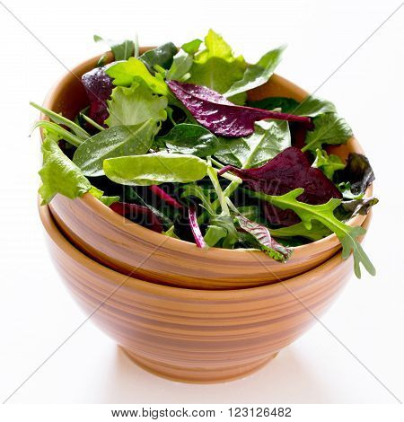 Mix Salad Arugula, Spinach, Chard, Oak Salad In Ceramic Cup On A White Background