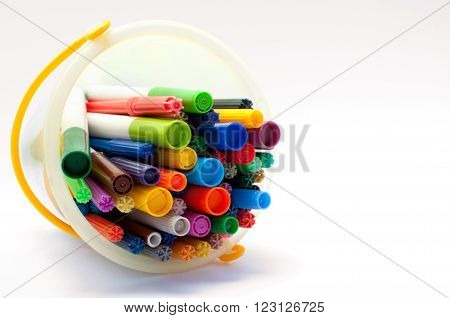 Selection of felt tipped pens lying in a bucket