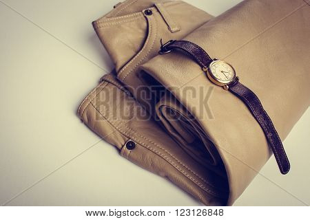 Women's clothes and accessories. Leather trousers and watches