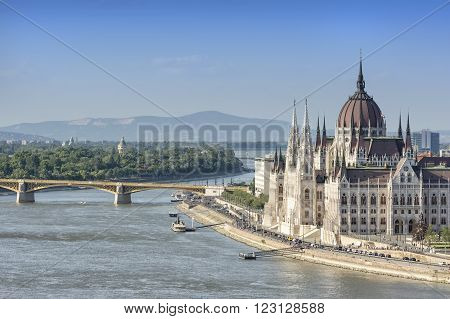 BUDAPEST, HUNGARY, JULY 10, 2015: View Of Danube River and Hungarian Parliament Building, the seat of the National Assembly of Hungary, one of Europe's oldest legislative buildings.