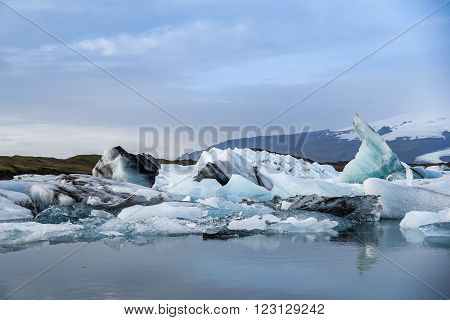 Iceberg in Jokulsarlon glacier lagoon in Iceland. Icebergs originating from the Vatnajokull, the biggest glacier in Europe