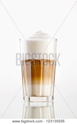Latte Macchiato coffee in a glass isolated on white background