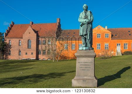 Hans Christian Andersen statue near the river in Odense Dernmark