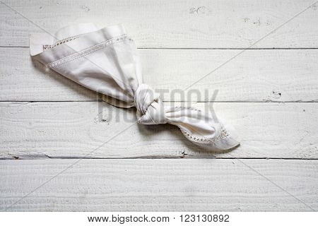 reminder knot in an old handkerchief on a white painted wooden floor with copy space vitage style concept of alzheimer's disease and dementia