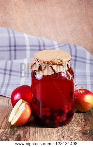 Sweet Delicious Compote Of Berries In Glass Jar On Wooden Table.