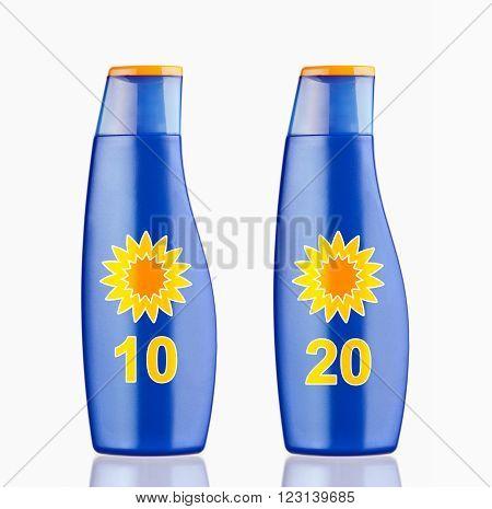 Blue plastic bottle of sun block cream on white background