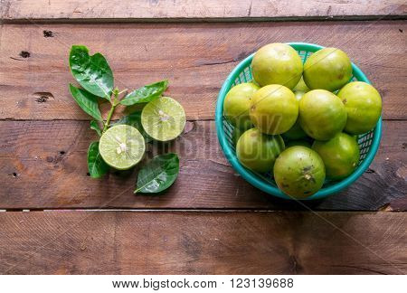 Lemons with leaves on wood (focus lemons dissect)