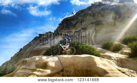 Mountain cyclist admires the views from the historic mountain of Tel Zafit (Gath of the Philistines).