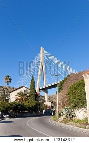 DUBROVNIK CROATIA - JANUARY 20 2016: Franjo Tudman Bridge (2002) a cable-stayed bridge carrying D8 state road to Dubrovnik Croatia across Rijeka Dubrovacka near Port of Gruz. Design Zlatko Savor