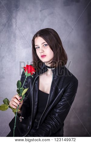 Teen Girl On A Dark Background In Leather Jacket With Red Roses