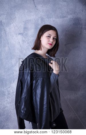 Teen Girl In Studio Posing On A Dark Background