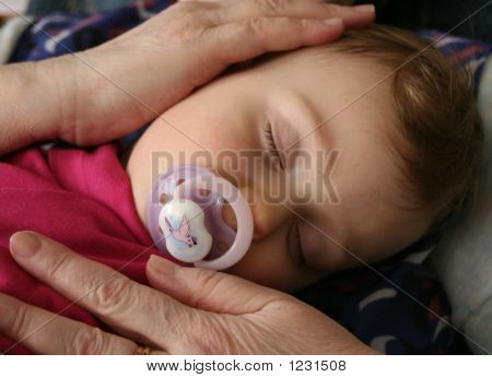 Child In Grandma'S Hands