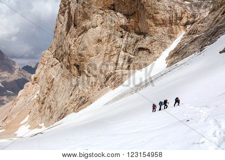Trekking in Himalaya Hikers Walking Up on Glacier in Nepal India Himalaya Way up to high altitude famous attraction with Snow