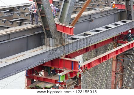 WESEL - SEPTEMBER 6: Industrial carrying platform supporting a bridge deconstruction on Rhine river, Germany on September 6, 2012