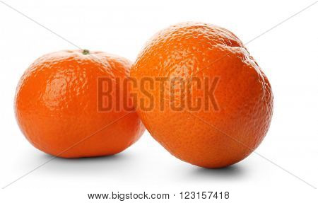 Two fresh tangerines isolated on white background, close up