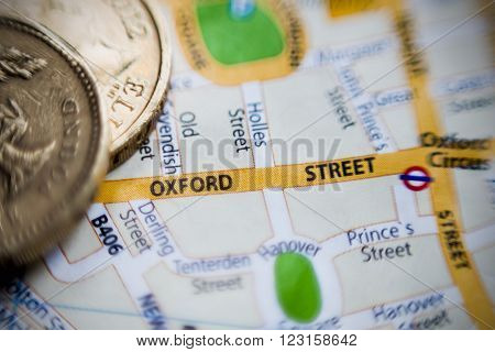 LONDON, UK - March,02, 2016. Oxford Street. London UK map and pounds coins