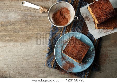 Few delicious chocolate cakes on wooden background