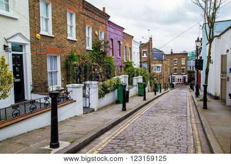 LONDON, UK - April, 13, 2015. London street of typical small 19th century Victorian terraced houses without parked cars