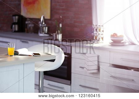 Modern kitchen interior with white furniture and electric stove