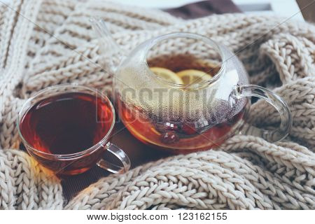 Cup of tea and woolen scarf, closeup