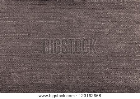 rough texture of old material from cotton or from a sackcloth for a textile background or for wallpaper of brown color with attritions
