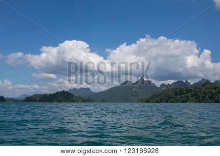 Beautiful mountains behind fog in Ratchaprapha Dam at Khao Sok National Park Surat Thani Thailand