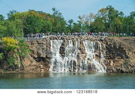 Dnepropetrovsk Ukraine - September 14 2013: View of the green river island with waterfall on a clear sunny day