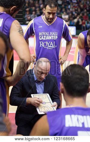 SAMARA RUSSIA - NOVEMBER 06, 2013: Timeout. BC Royal Hali Gaziantep head coach Aziz Bekir during a timeout of the BC Krasnye Krylia basketball game on November 06 2013 in Samara Russia.