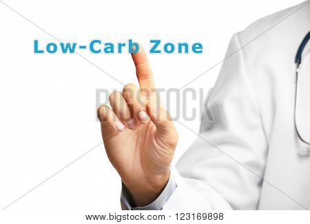 Doctor pointing on Low-Carb Zone text isolated on white