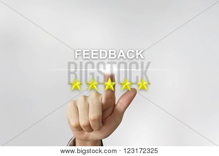 business hand clicking feedback with five stars on screen