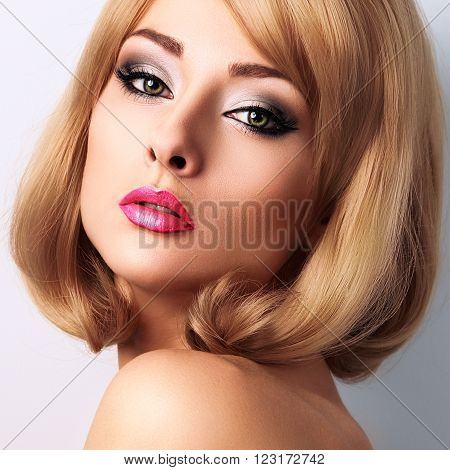 Beautiful makeup woman with long lashes and pink lipstick. Short blond hairstyle. Closeup bright portrait