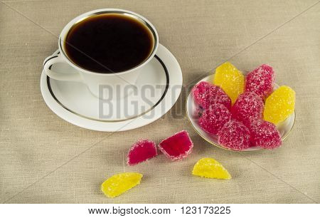 Cup of coffee and a sweet colorful jelly candies. ** Note: Visible grain at 100%, best at smaller sizes