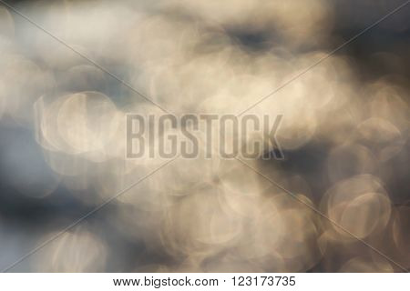 Dreamy abstract sparkle shining water surface bokeh light crystalline background