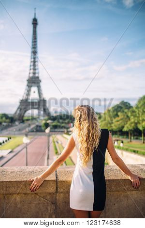 Elegant Parisian woman in Paris  near Eiffel Tower