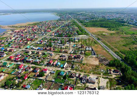 Aerial view onto Novaya Ozernaya - New Lake street. Near federal highway Tyumen-Omsk