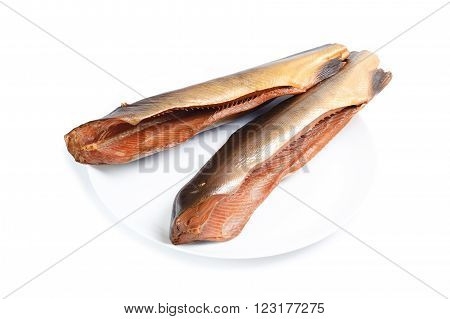 Smoked pink salmon on plate isolated on a white background