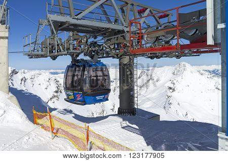 HINTERTUX GLACIER, AUSTRIA - MARCH 17, 2016: Cableway in the Austrian Alps. Mact and gondola. The top of the Hintertux Glacier 3250 meters above sea level.