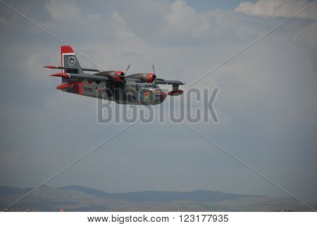 ANKARA TURKIYE MAY 6, 2012 : Canadair CL-215 firefighting aircraft over the Etimesgut airport before the water dump mission. May 6, 2012-Ankara/Turkey